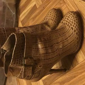 Gator skin ankle boot with 5 1/2 inch heel.